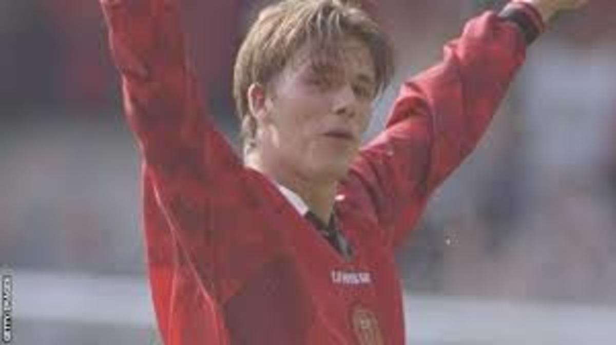 A young David Beckham scoring for Man Utd.