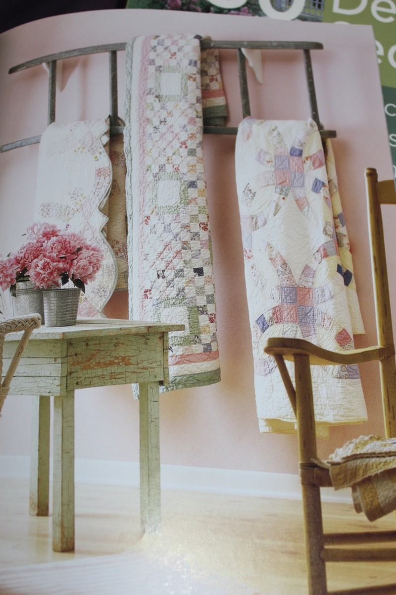 This is one of my favorite ways to use a ladder. I have my own quilts displayed the same way.