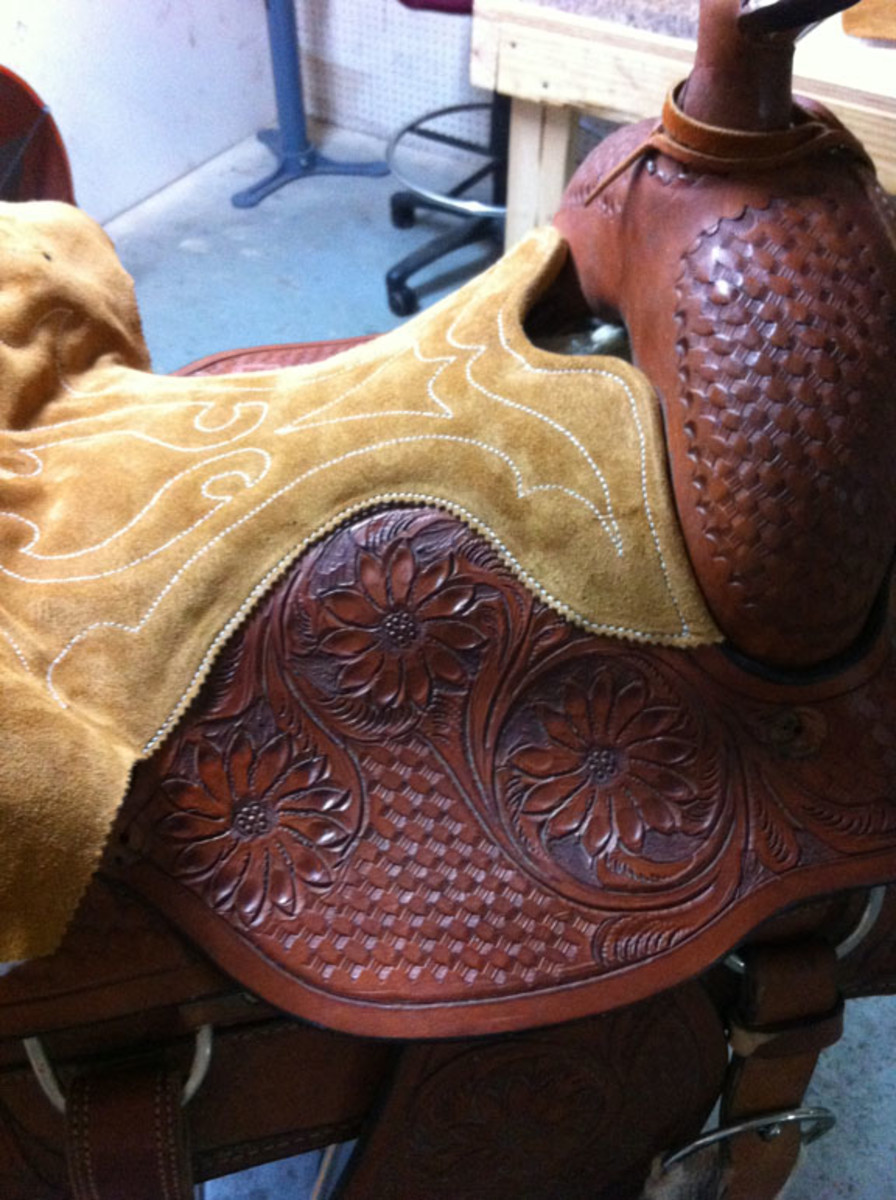 Sides of seat sewn during western saddle seat replacement