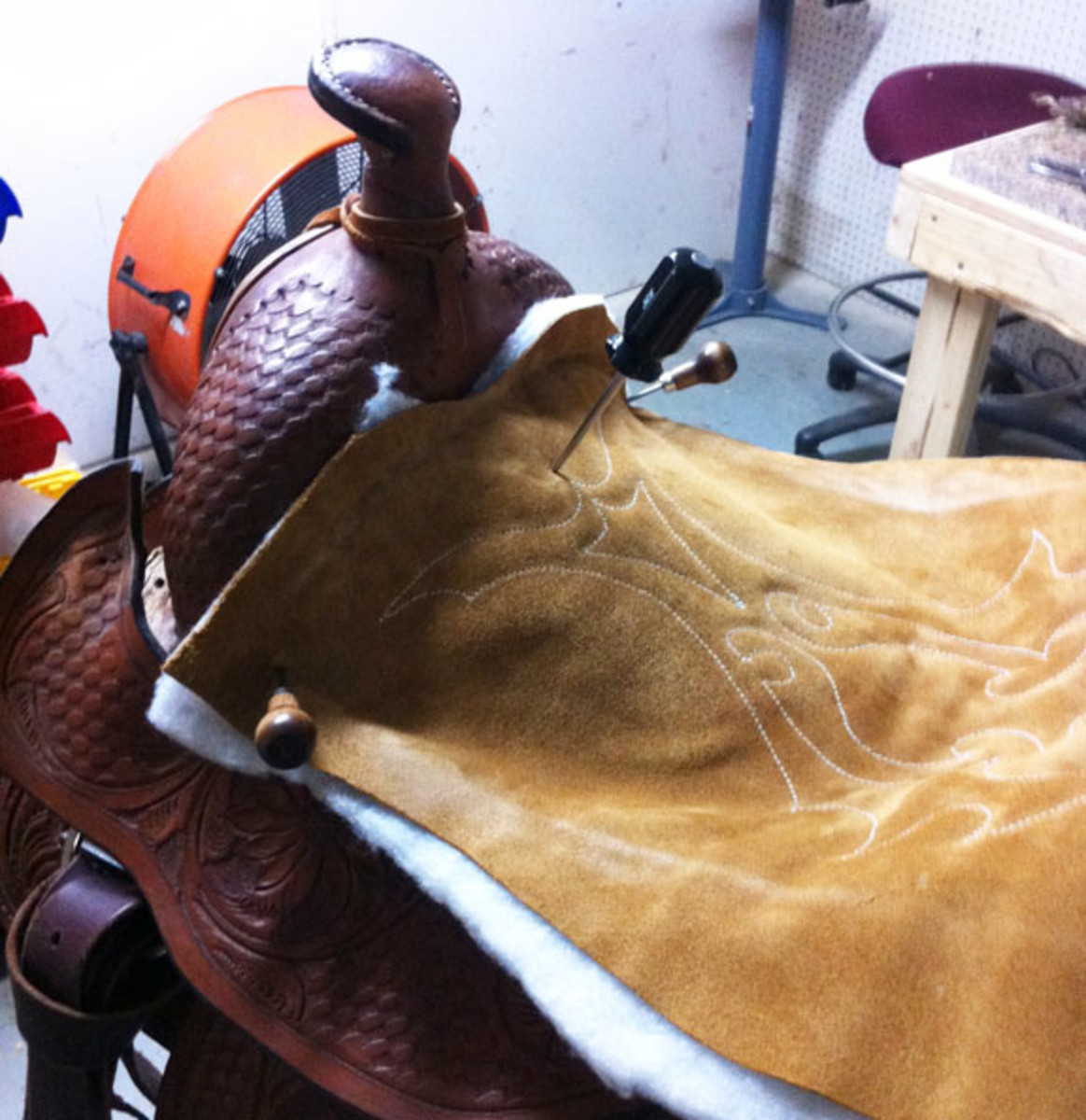 Fitting new seat leather at front to western saddle