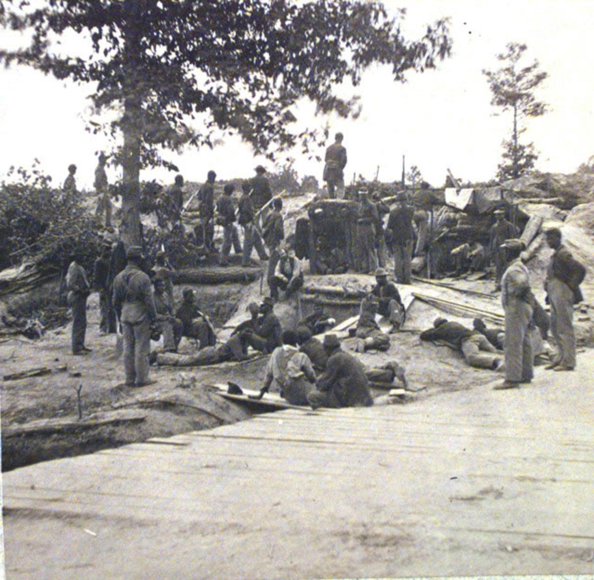 Colored troops behind breastworks outside of Petersburg, VA