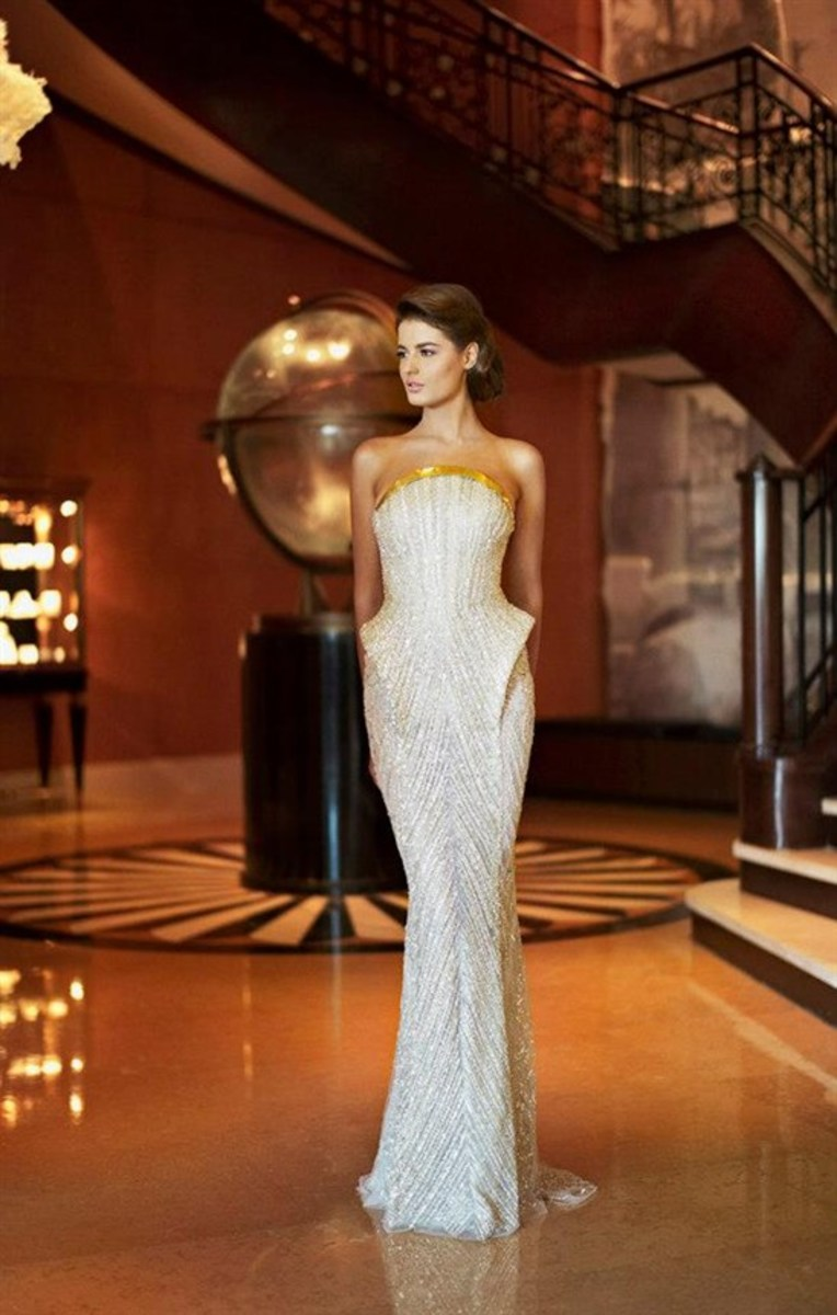 Beautiful silhouette in shimmery white by Zaid Nakad from his 2013 Winter collection