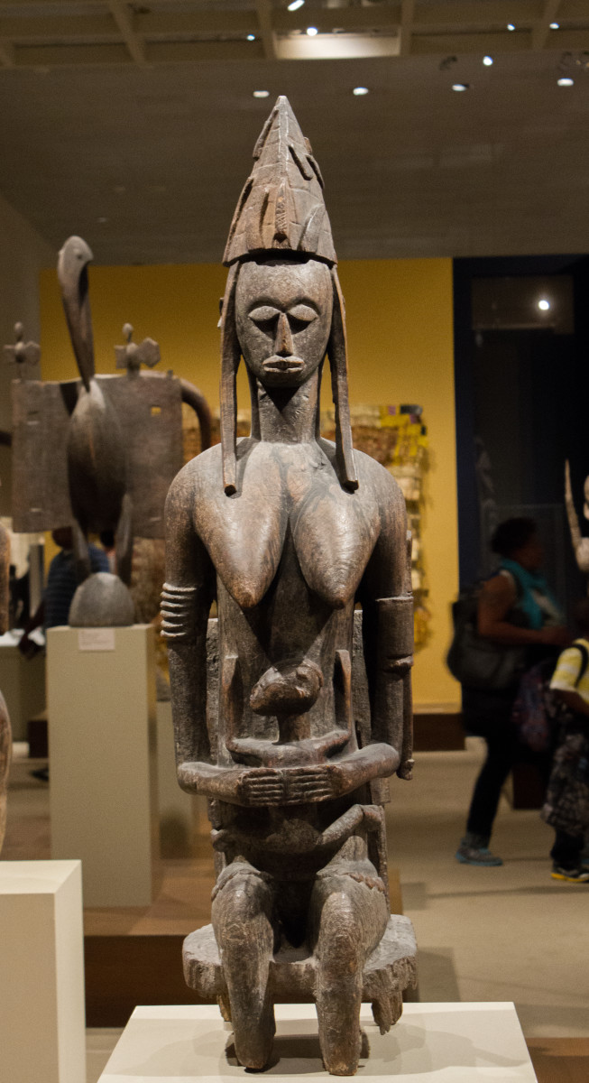 This African statue is of the primordial male, the first man. It shows him sitting tall and proud.