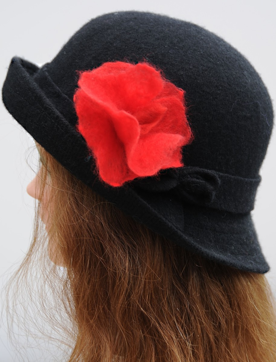 Red rose on a hat