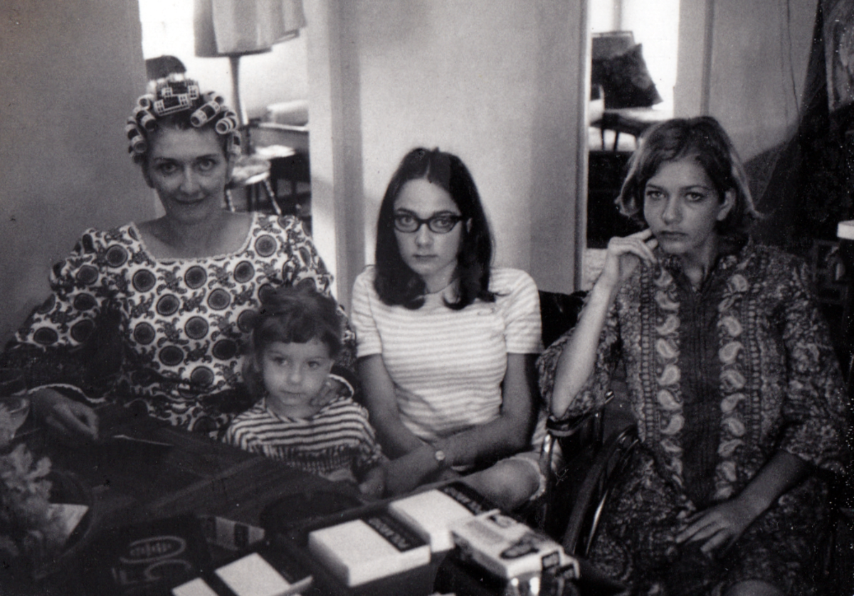 My mother, myself, my eldest sister and my youngest sister.  I have only a few memories from this time of my life.