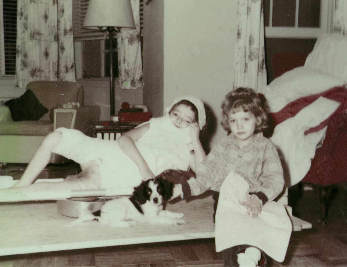 My eldest sister in the body cast, my youngest sister in front, with a puppy.