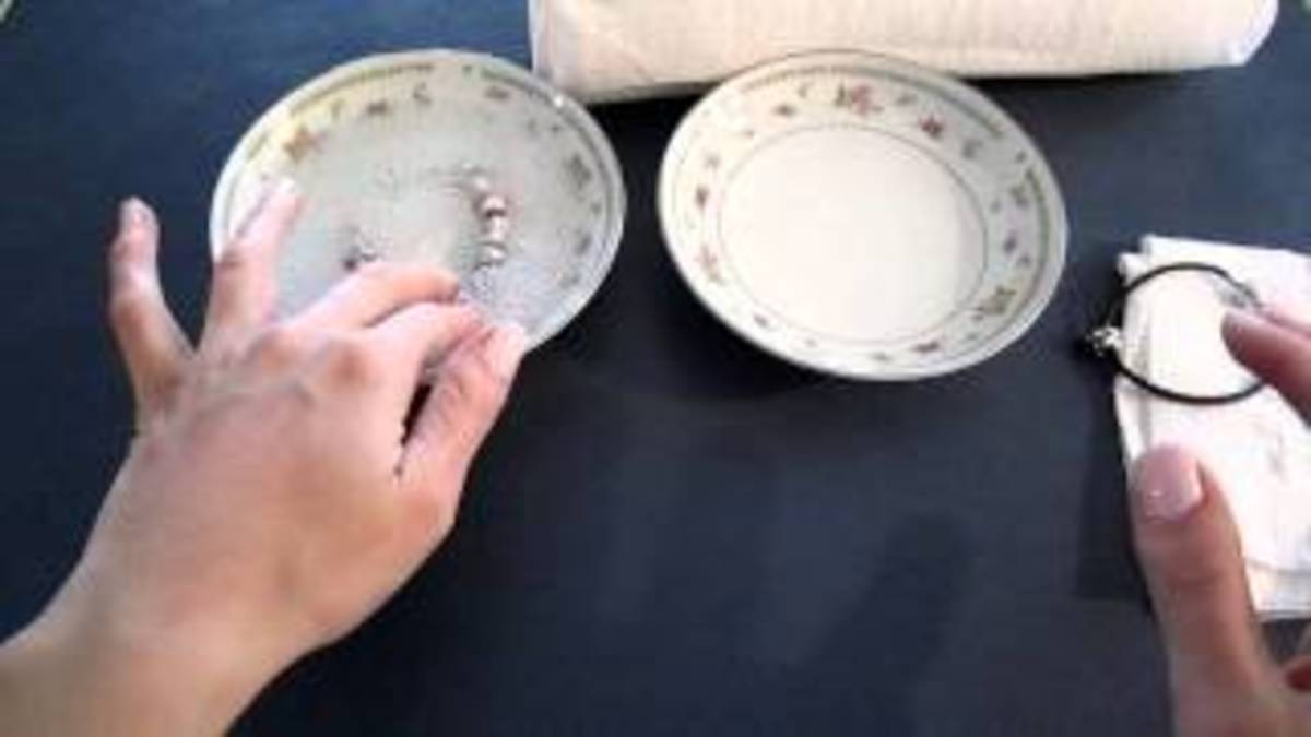 cleaning your Pandora Style charm bracelets and its charms - two bowls of water and a soft cloth