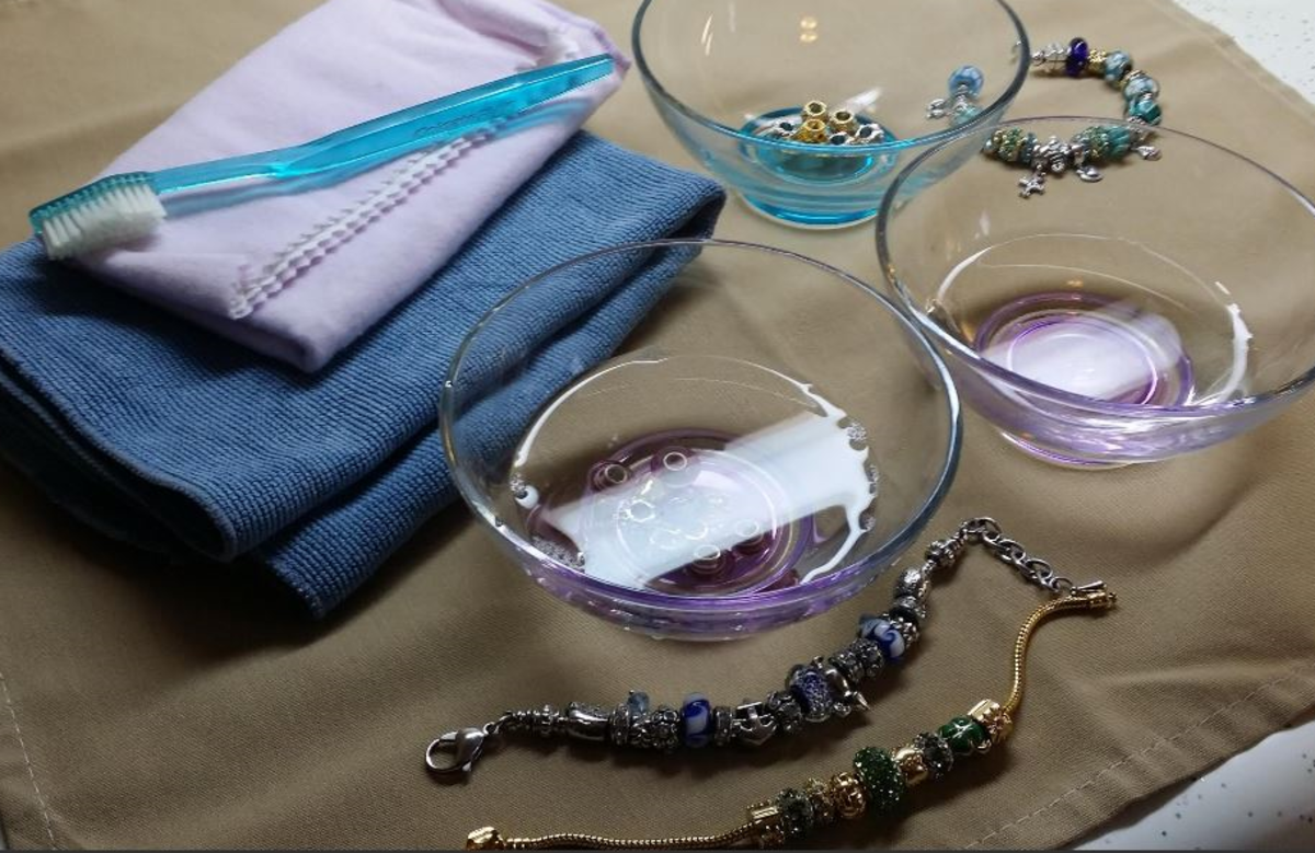 how to clean Pandora style charms and bracelets - photo of three bowls, soft cloth, polishing cloth and toothbrush