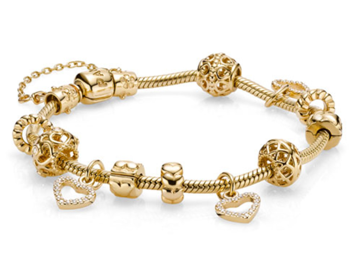 Extravagant 14ct Gold Pandora Bracelet - Gold Moments Charm Bracelet £1,200; 14ct Gold and Diamond Valentine's Heart £360; other charms from £165,