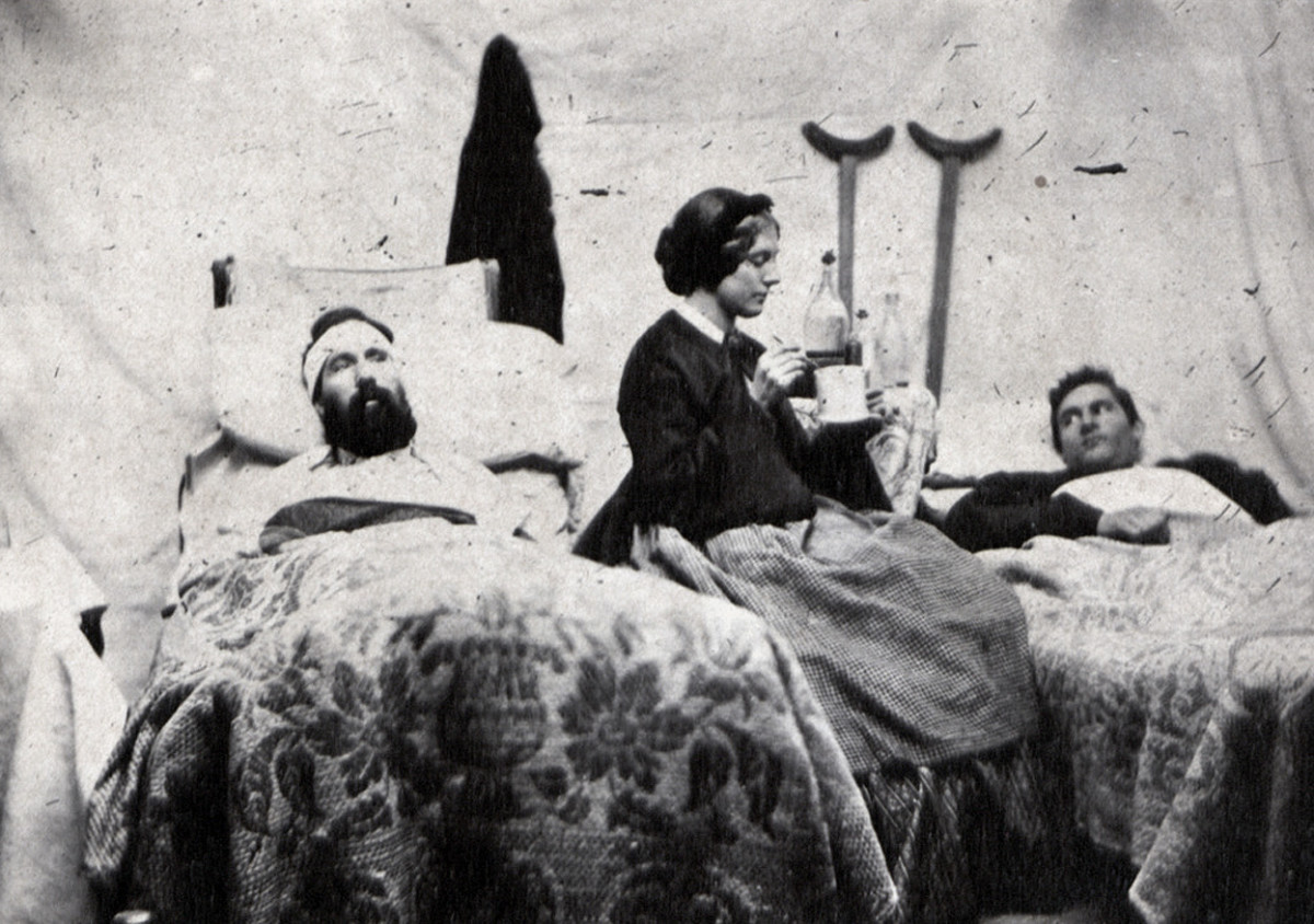 A nurse offers a small comfort. Note the pair of crutches against the wall