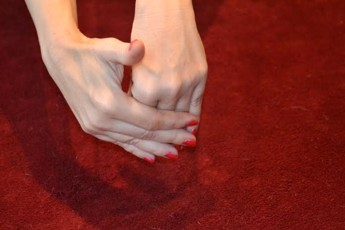 Palm down hand stretch will make the joints st the bottom of your fingers more flexible