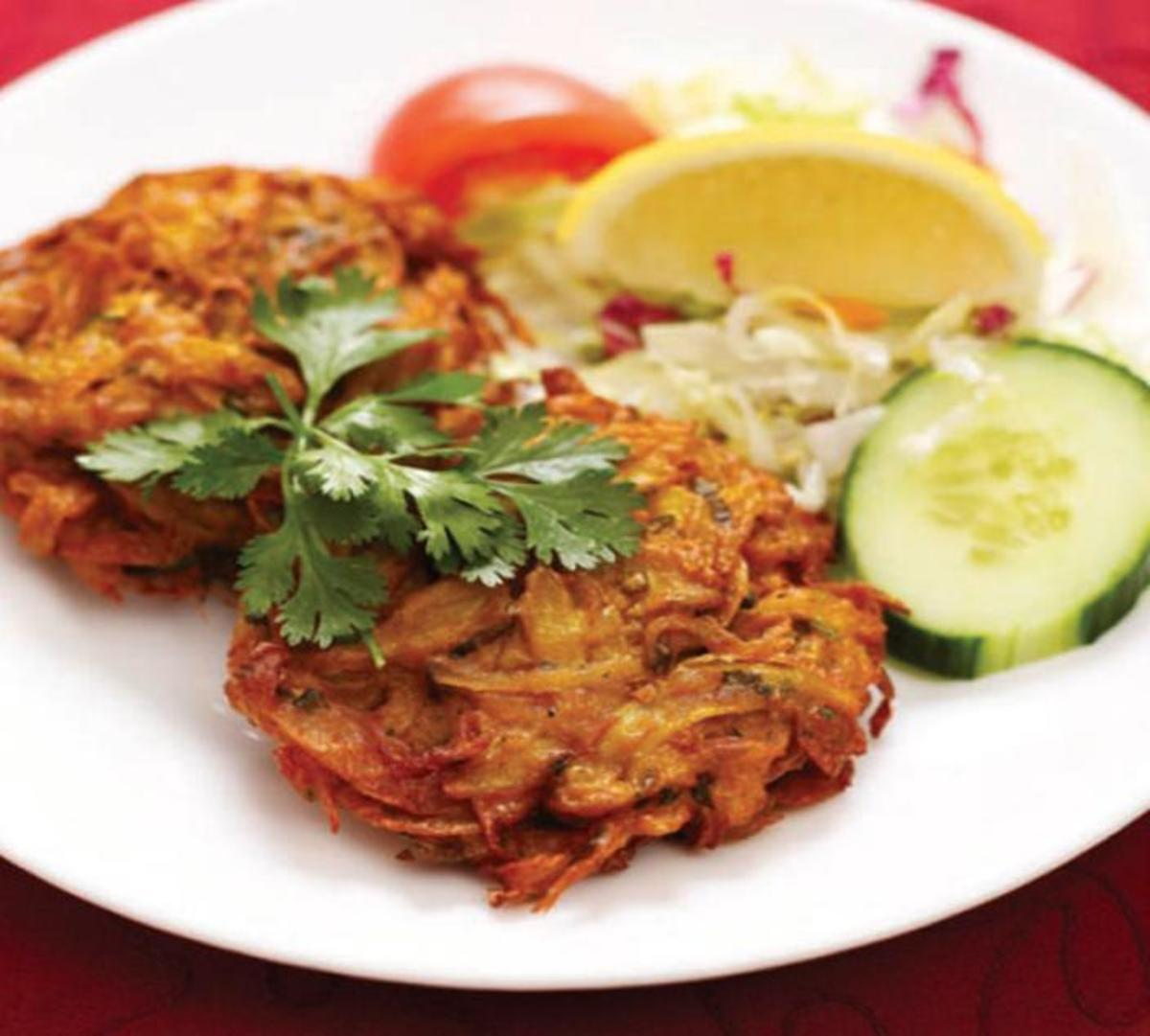 How to make an onion bhaji. A great Indian starter plus delicious mint sauce and mango chutney recipes.