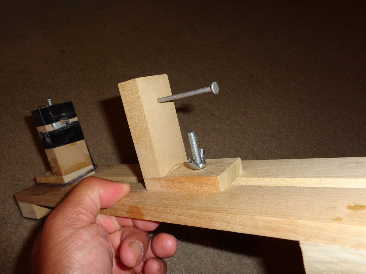 Large Nail, Nut, and Bolt (Wing Nut), and Left Mount in place.