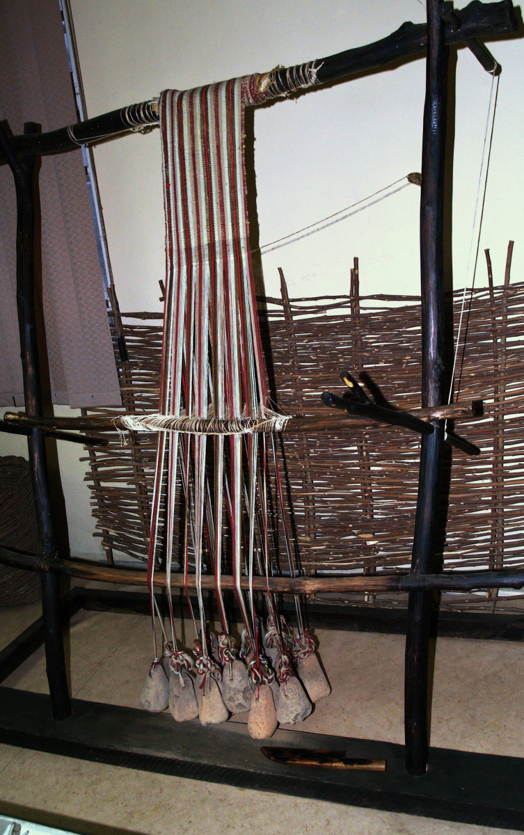 This reconstruction of a neolithic loom shows loom weights at the bottom of the apparatus.  (At the National Museum of Textile Industry, Sliven, Bulgaria)