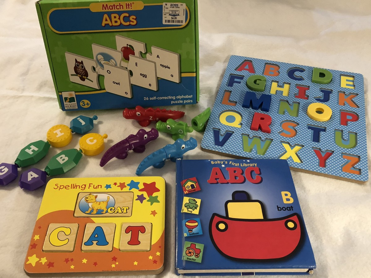 Alphabet puzzles, books, popbeads, alligators, and word activities