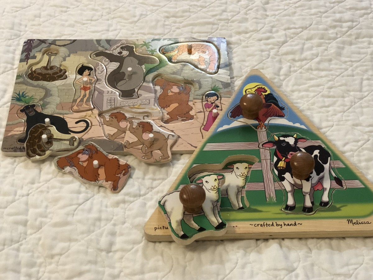 Disney Jungle Book puzzle with small knobs. Farm animals puzzle with jumbo knobs.