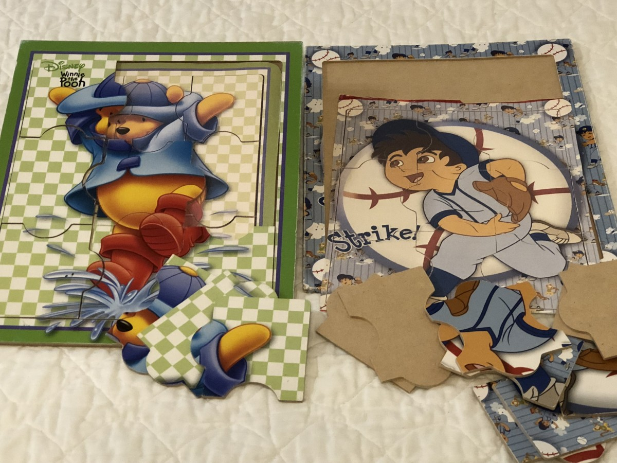 I took pictures of the assembled puzzles with my phone, printed, then trimmed to size for the puzzle board.