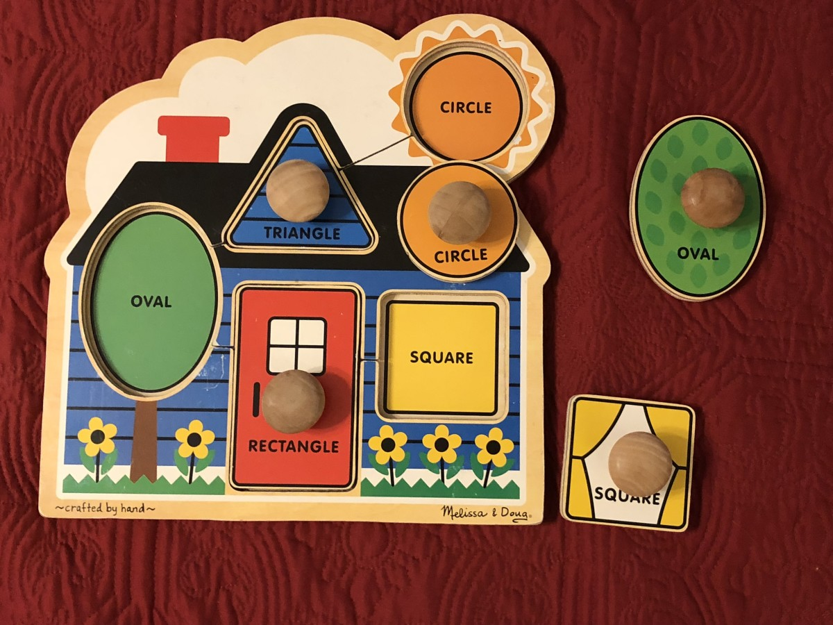 This house shape puzzle with large knobs is a favorite. It is often the first puzzle that some of my clients are able to successfully complete.