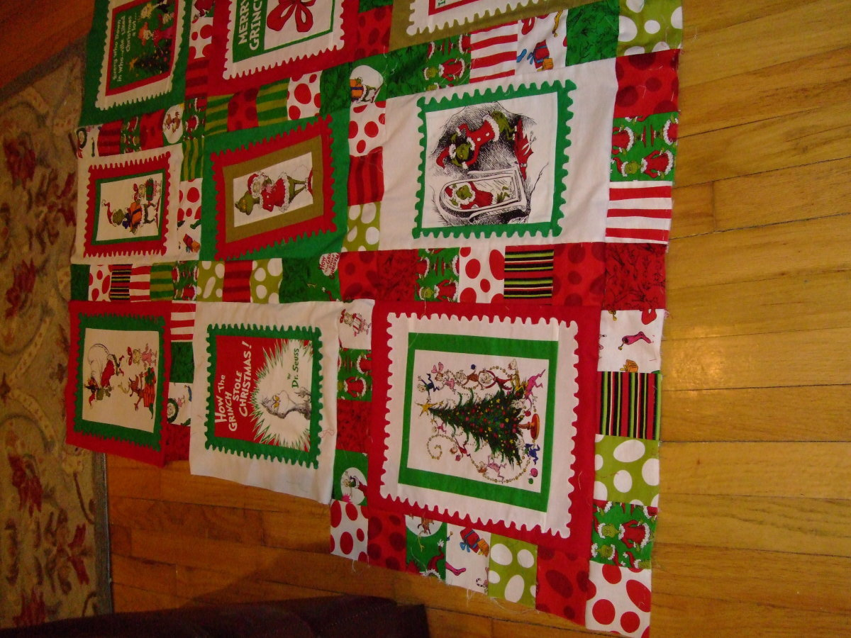 ...getting close to finishing a quilt the Grinch would admire!!!