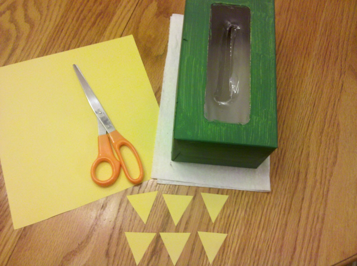 Cut 6 small triangles to attach to the front of the box for the toes.