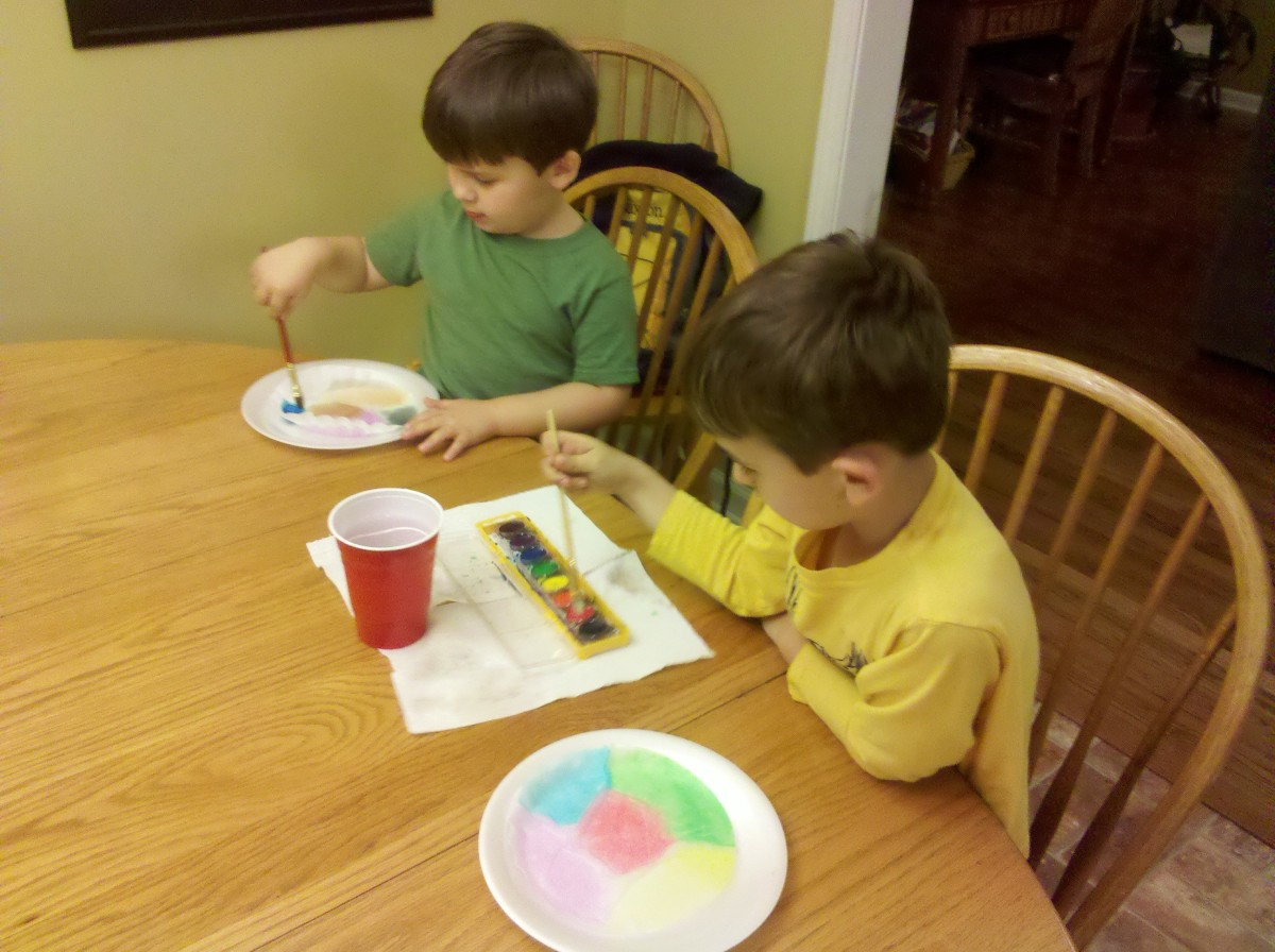 Flatten your coffee filter on a paper plate and paint with watercolors.