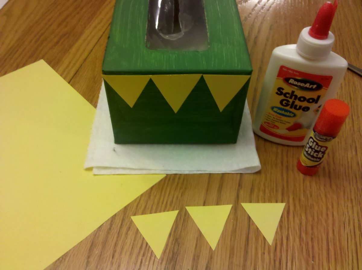 Glue 3 triangles to the front of each box.