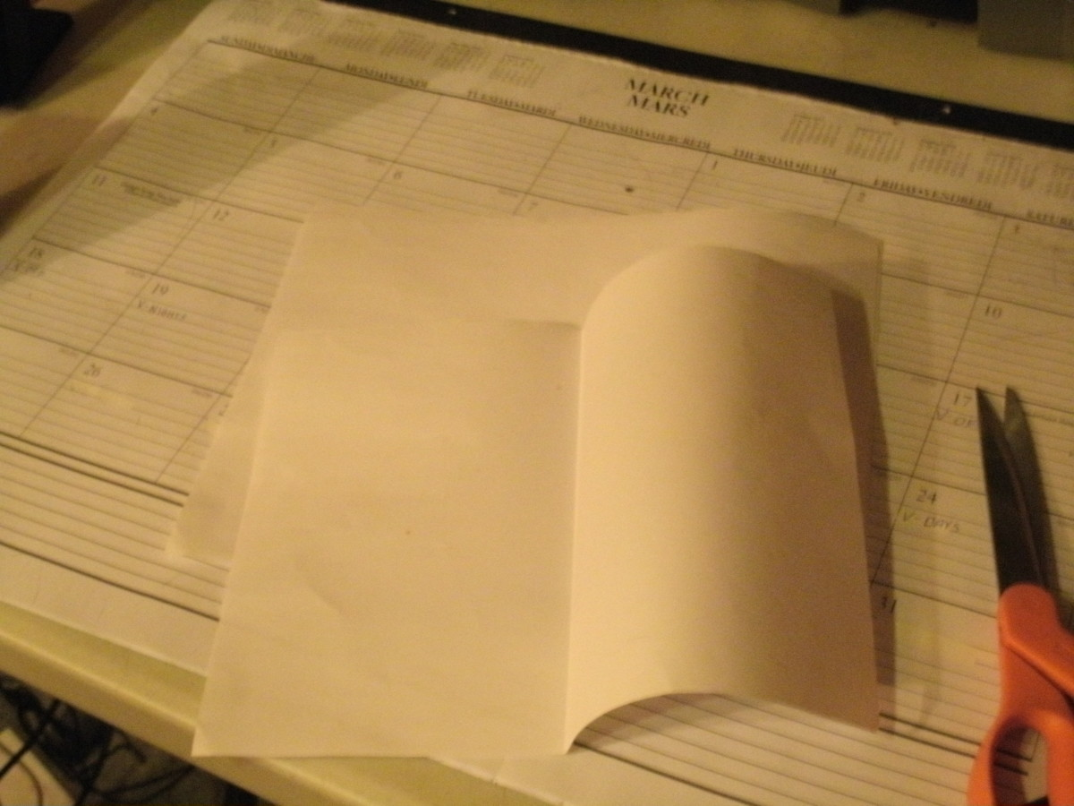 "Take a 8.5""x11"" piece of paper, and fold it in half."