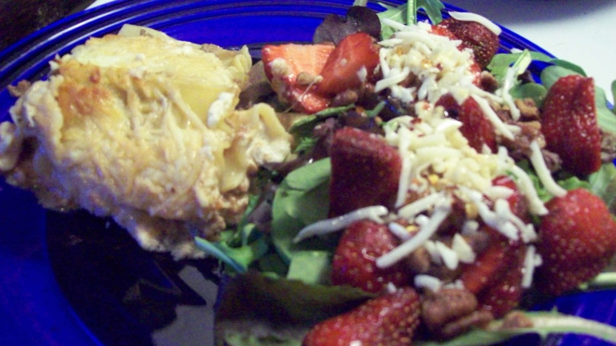 Yummy veggie lasagna with baby greens and strawberries.