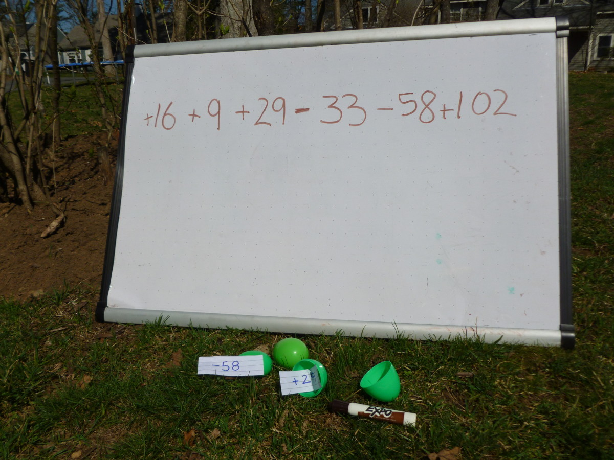 The kids write the numbers they find in the eggs onto the white board (or paper).
