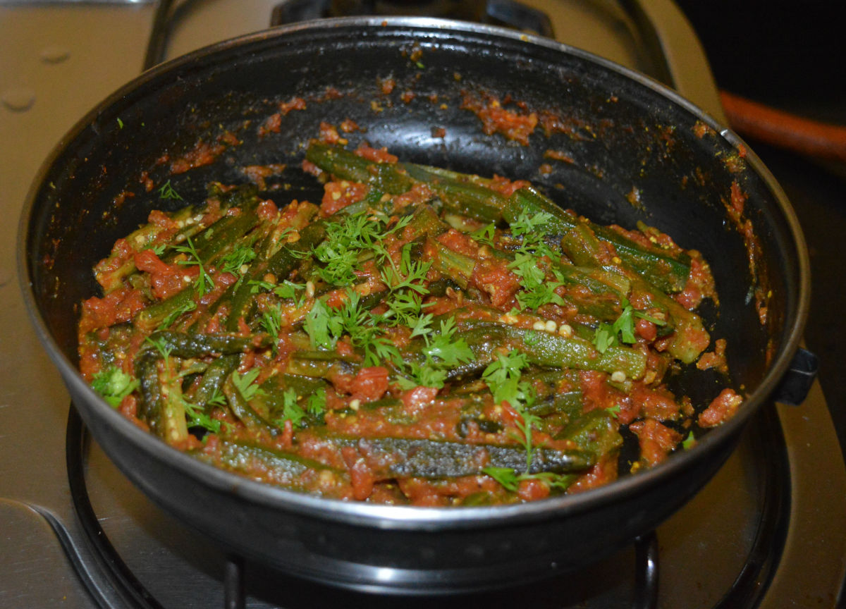 Add chopped coriander leaves. Mix well. Turn off the heat. Transfer the curry to a serving dish.