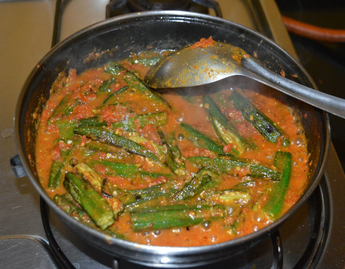 Step five: Reduce the heat and add okra. Stir the mixture well.