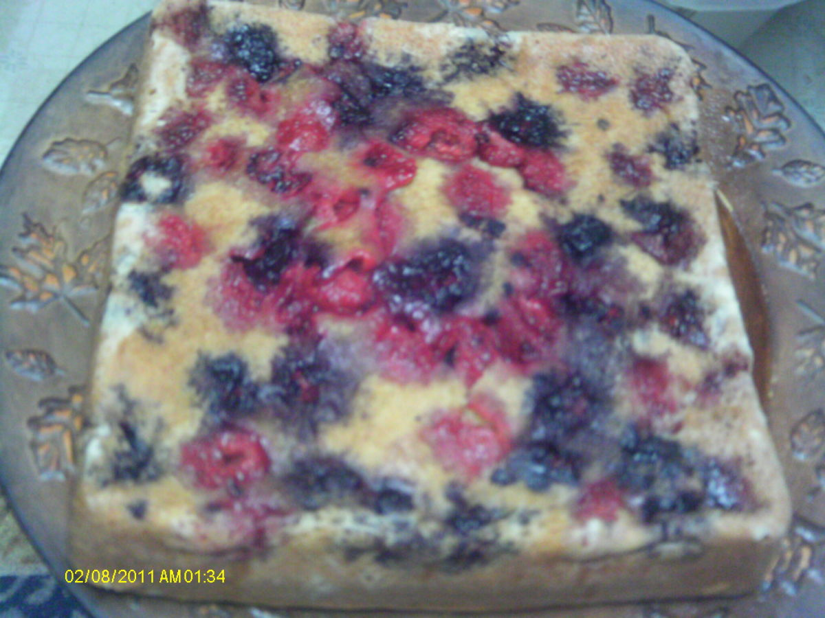Blackberries and raspberries in a yellow cake