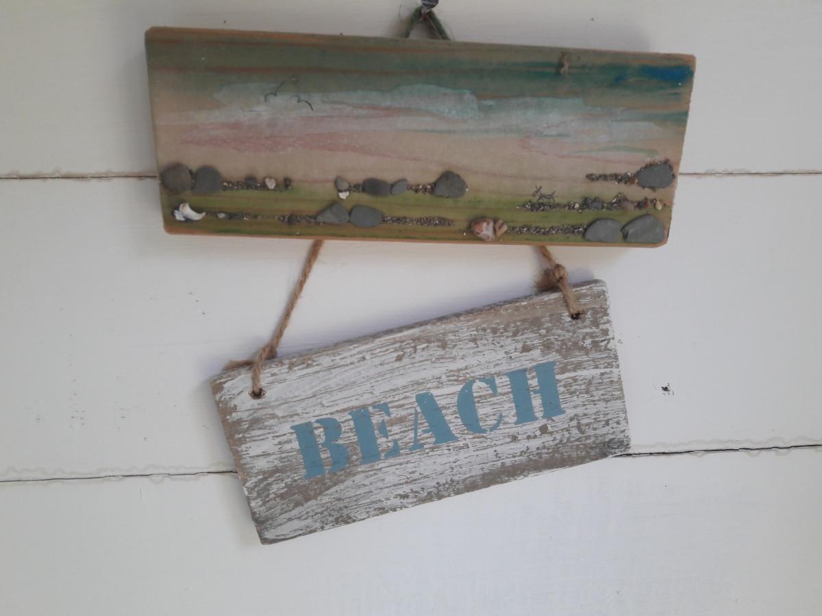 Seaside themed wall hangings.