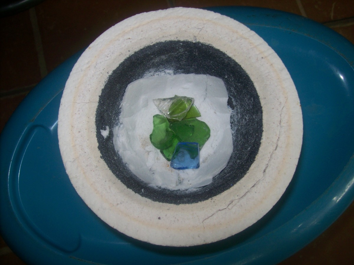 Six or seven small  pieces of glass can give a nice puddle of fused glass. Pile them up a bit.