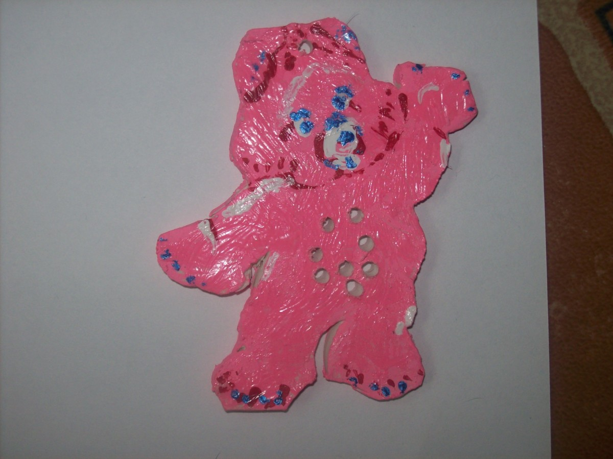 """I used  7/64"""" drill bit in a Dremel tool. A drill motor works fine too. Drill the holes before painting. The bear will look clay white."""