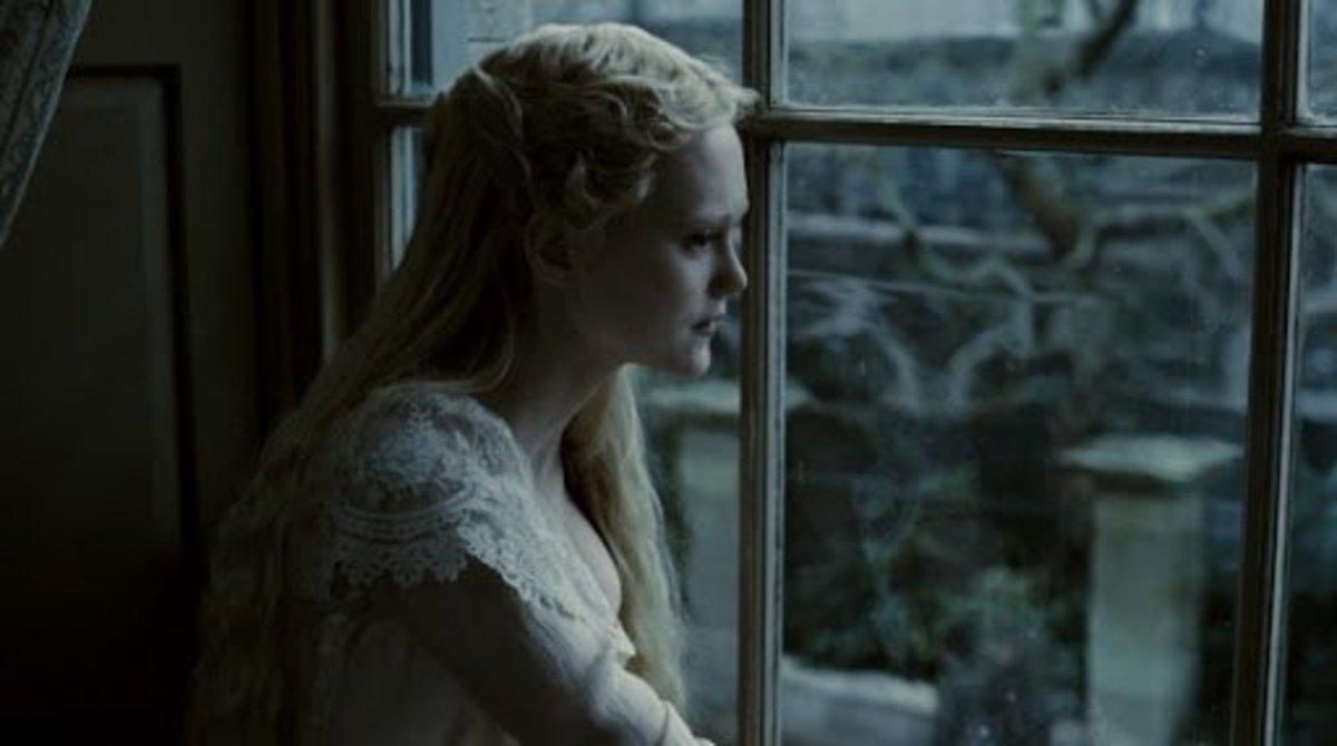 Johanna gazes sadly out the window.