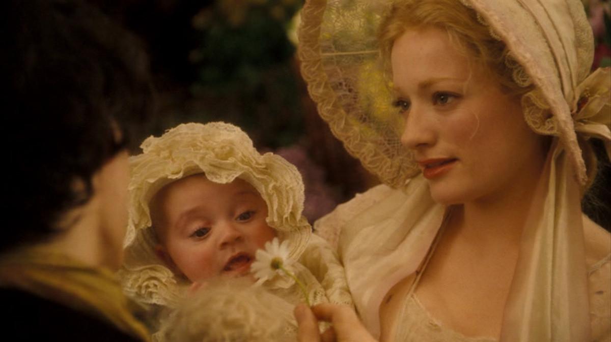 Lucy holds baby Johanna.