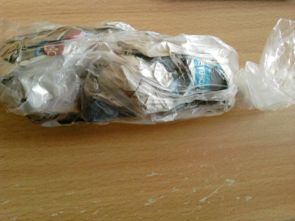 Put the newspaper into a freezer bag.