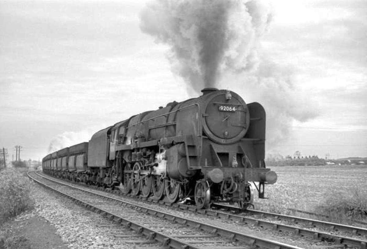 British Railways 9F 2-10-0 with train of 56t ironstone hoppers at Pelton between Tyne Dock and Consett  - the class was fitted with air pumps to operate the doors on the 56 ton iron ore wagons pictured above