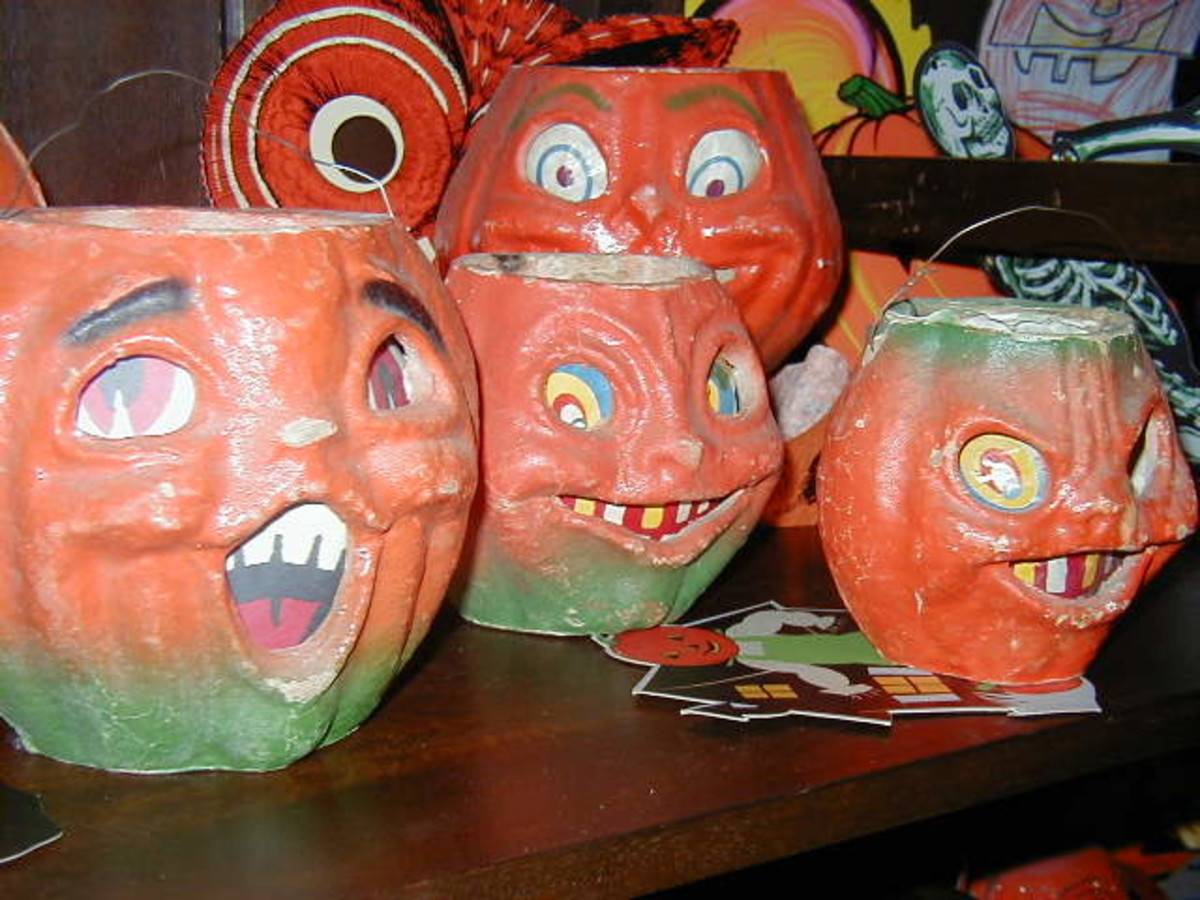 Whether those pumpkins are grinning or scary, they are amazingly expensive if they are not reproductions.