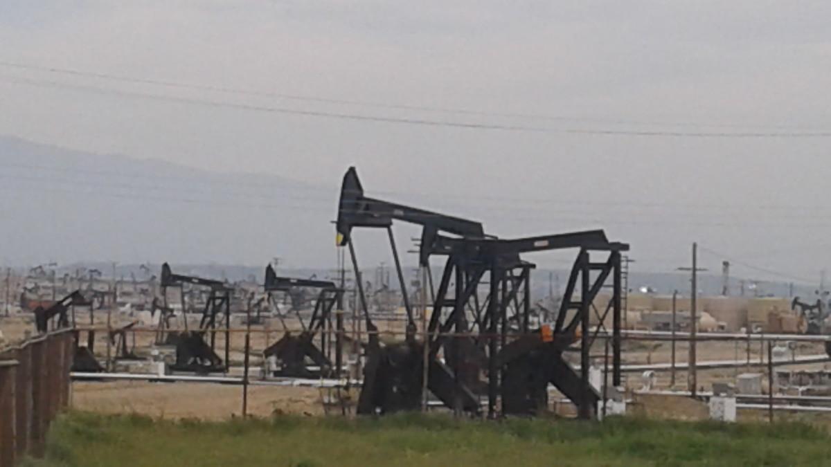 Derricks, thirsty for oil...