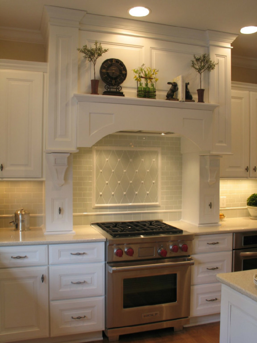 Old World kitchen design with standard tiles installed diagonally with accent deails makes this kitchen backslash customized and reminiscent of the Victorian era