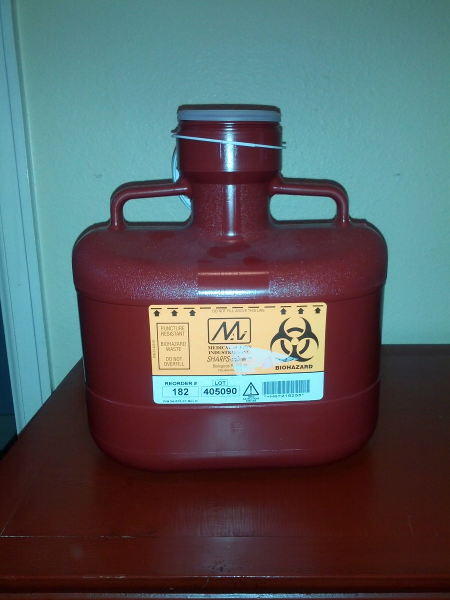 Sharps container used to dispose of used needles.