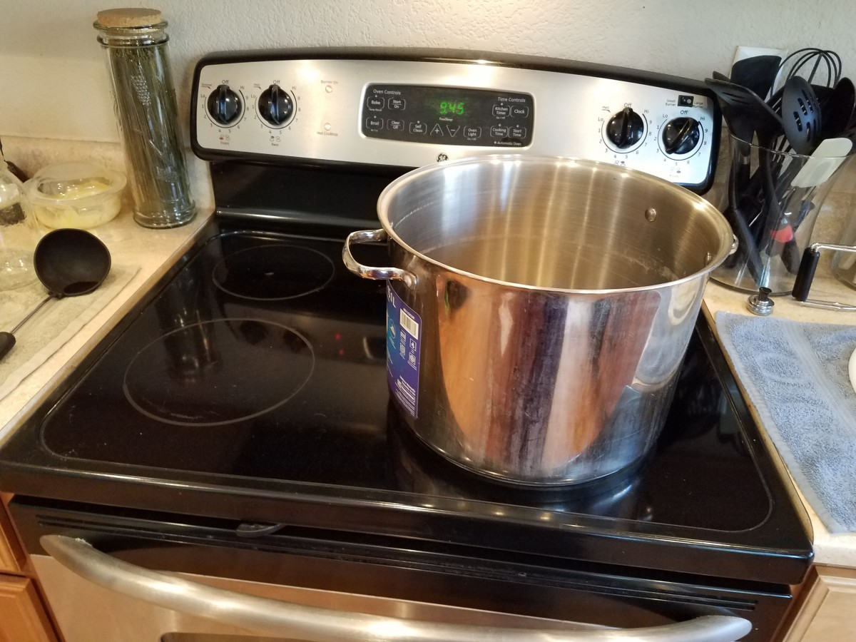 Step 2: I use my water bath canner to cook my pasta sauce and then wash it with soap and water before canning with it.