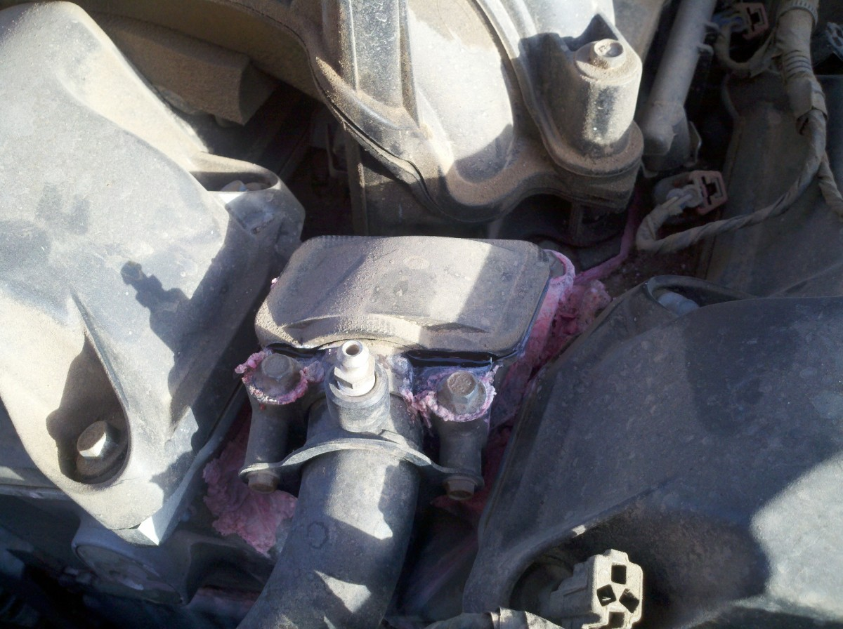 How to Replace a Water Coolant Outlet on a Dodge Charger (2006-2009) with 2.7L Engine