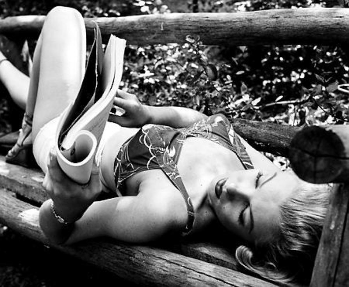 Marilyn Monroe reading what looks like a script.