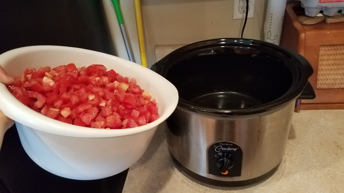 Chop up all of your tomatoes and add them to the crockpot.