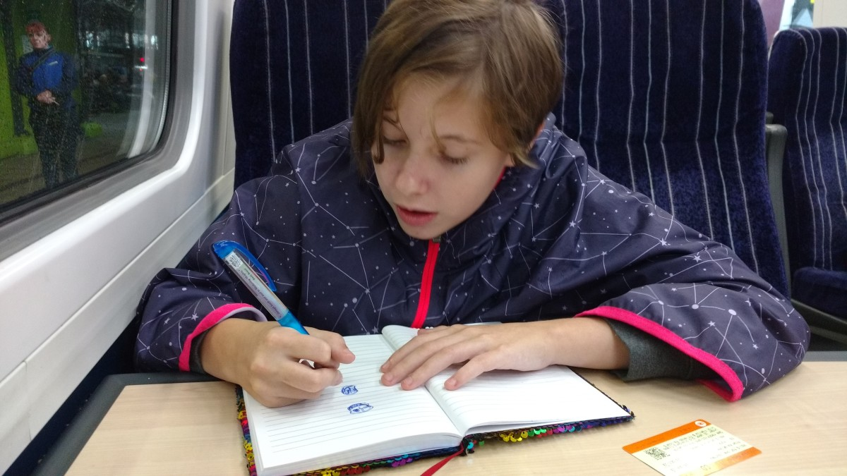 Our granddaughter Josie on train ride back to London from York, very early one morning on this second journey to the UK.