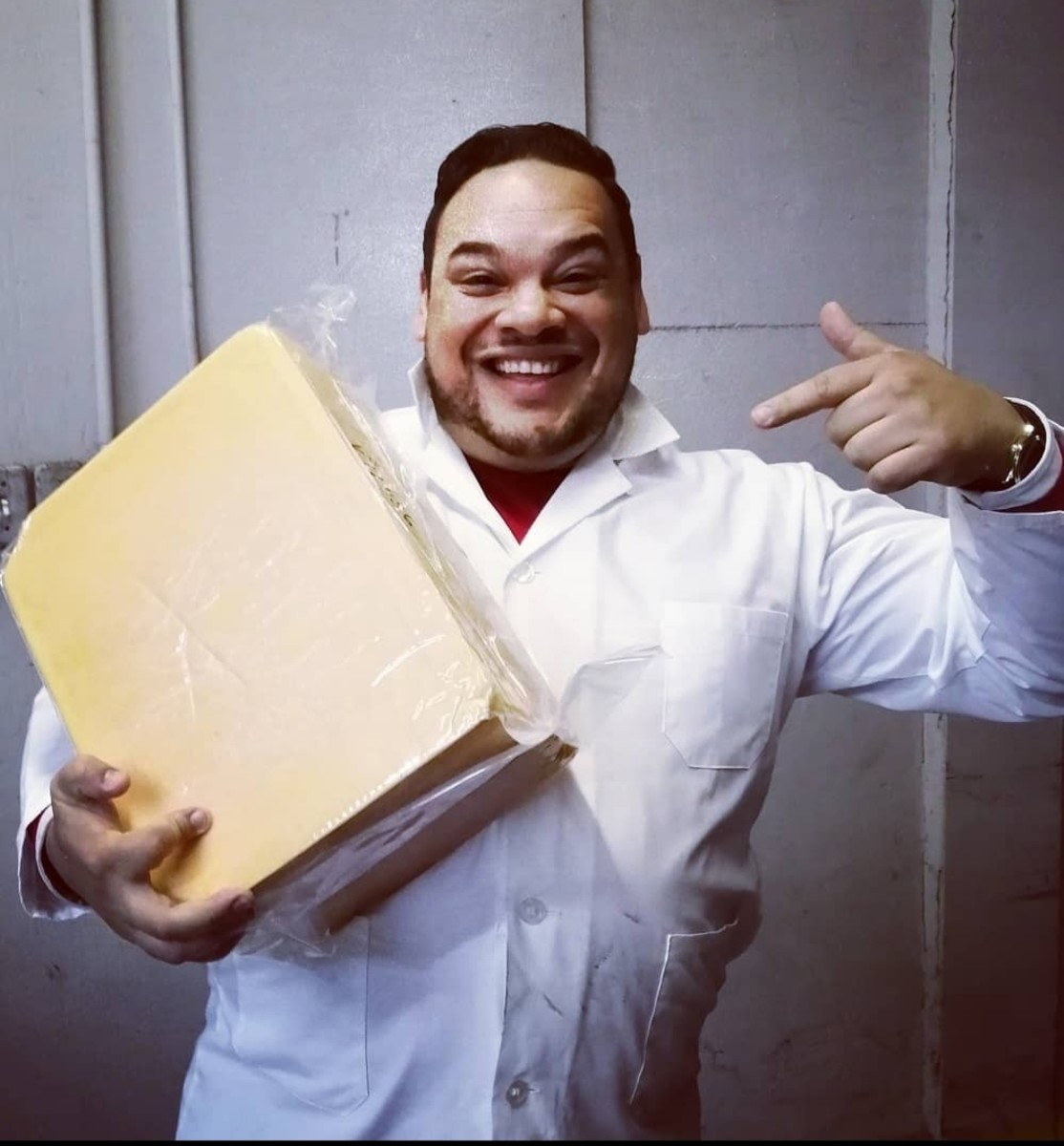 Andre Derrick judging cheese at the British Empire Cheese Show in 2019
