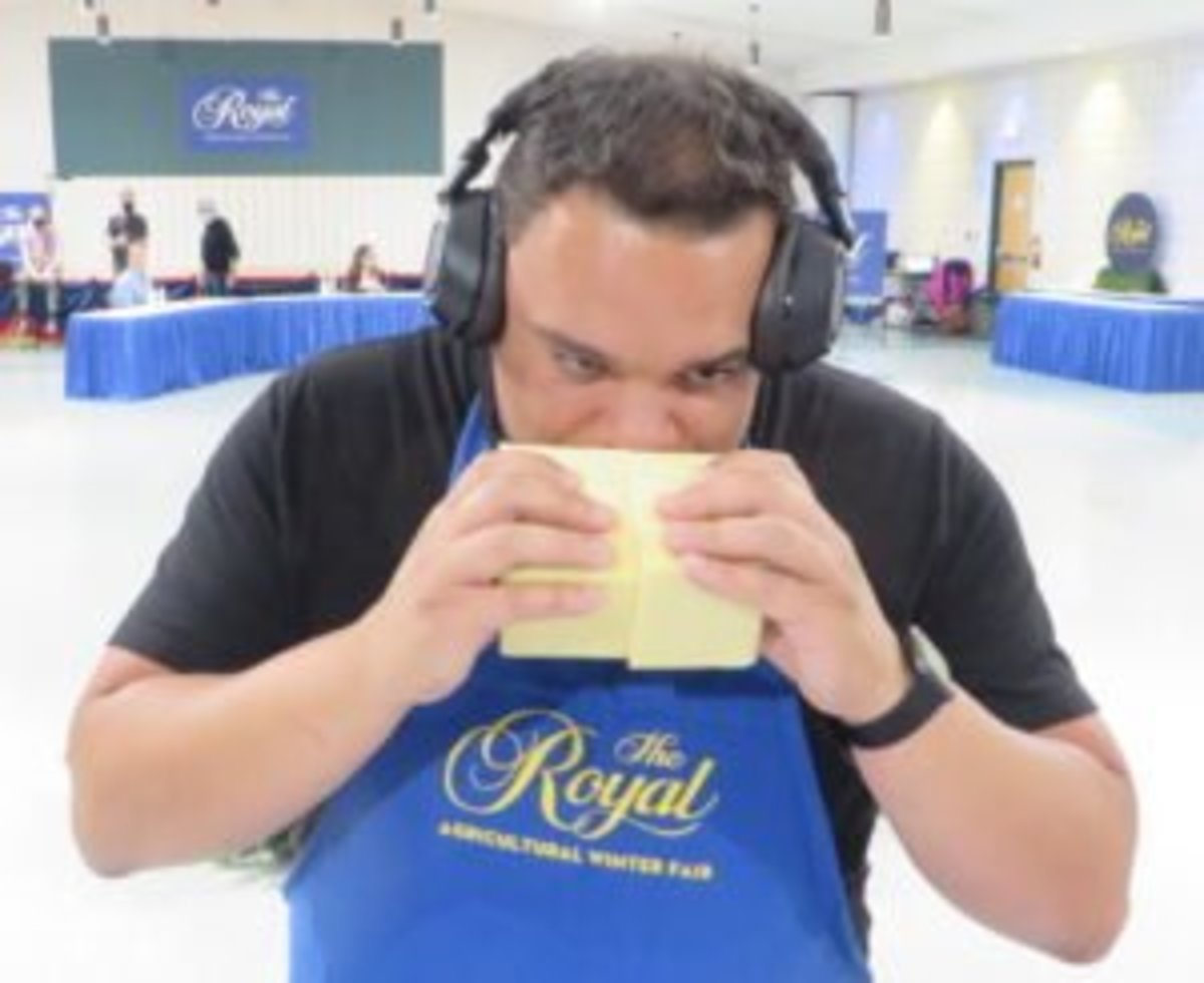 Andre Derrick judging cheese at Canada's largest and longest-running cheese competition, the Royal Winter Fair Cheese and Butter Competition in Toronto, Canada